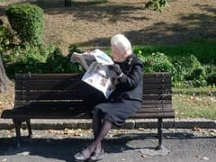 Having a break and taking time out to read a newspaper